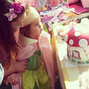 Birthday girl blowing out the candles with Angelina Sparkle Fairy